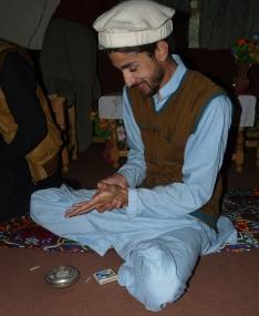 Preparing charas to smoke, Chitrali Hindu Kush, Pakistan, 2015